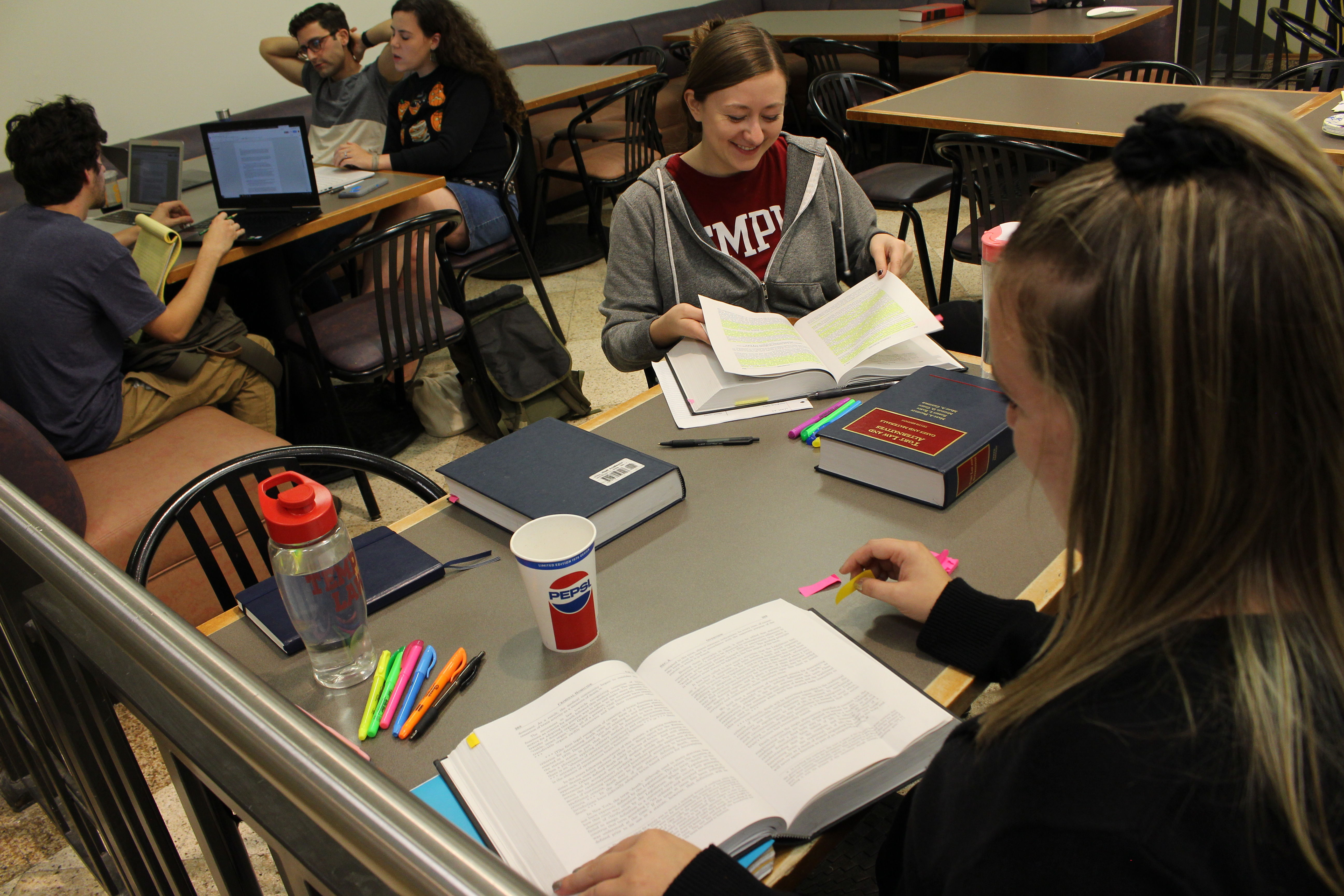 Temple Law students preparing for Introduction to Transactional Skills in October of 2018 in the Klein Hall cafe.