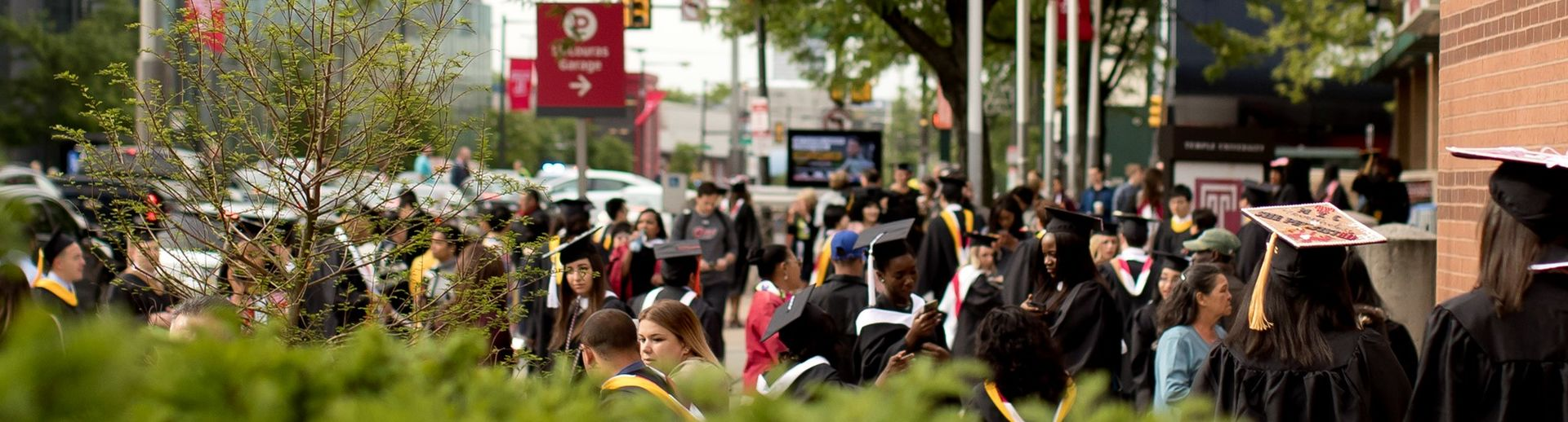Students gathering on broad st for Commencement